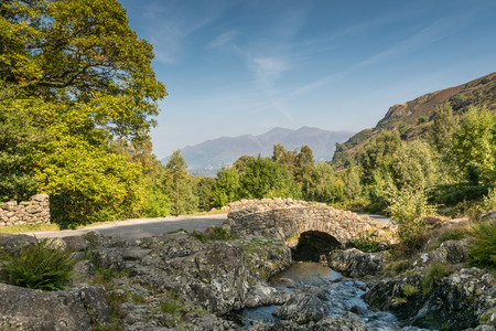 old packhorse bridge: Ashness Bridge with Derwent Water, Keswick and Mount Skiddaw beyond is an old single track packhorse bridge