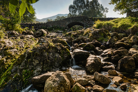 old packhorse bridge: Ashness Bridge from downstream is an old single track packhorse bridge Stock Photo