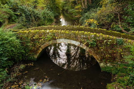 Sandstone Bridge in Jesmond Dene which is a deep post-glacial valley providing a quiet haven just one mile from Newcastle Upon Tyne city centre photo