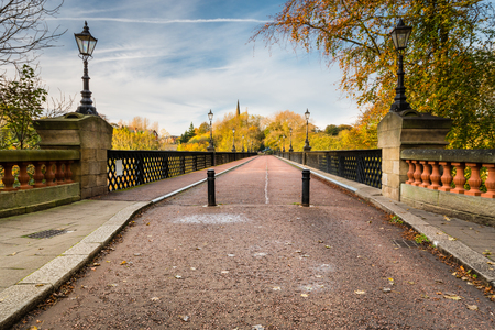Armstrong Bridge spans Jesmond Dene and is constructed of iron