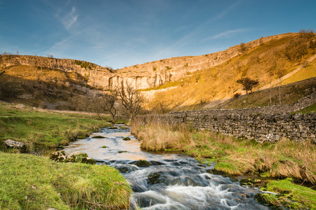 Malham Beck flows from Malham Cove  Malham Cove in Malhamdale is a popular tourist attraction of the Yorkshire Dales National Park