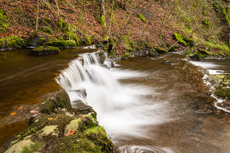 settle: Step in the Scaleber Force Waterfall  Scaleber Force or Foss waterfall near Settle in the Yorkshire Dales National Park Stock Photo
