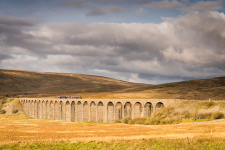 Ribblehead Viaduct with Train  The Ribblehead Viaduct carries the Settle to Carlisle Railway across Batty Moss spanning 400 m and 32 m above the valley floor