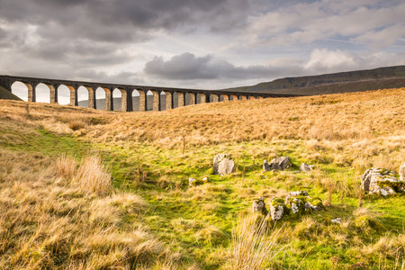 Yorkshire Dales: Ribblehead Railway Bridge  The Ribblehead Viaduct carries the Settle to Carlisle Railway across Batty Moss spanning 400 m and 32 m above the valley floor Stock Photo