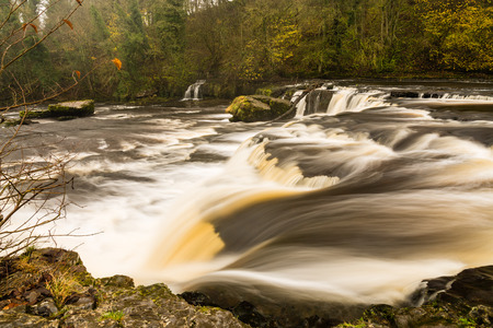 ure: Aysgarth Falls  Aysgarth Falls are a triple flight of waterfalls carved out by the River Ure over an almost one mile stretch in the Yorkshire Dales Stock Photo