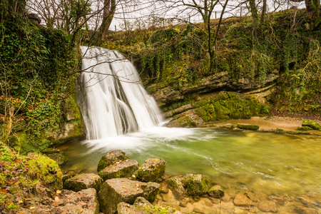 yorkshire dales: Gordale Beck flows over Janets Foss waterfall near Malham in the Yorkshire Dales National Park