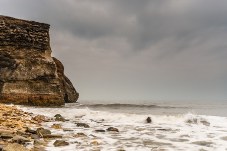 dumped: Cliffs of Noses Point  Noses Point is situated just south of Seaham and was once the location of Dawdon Colliery which dumped waste onto Blast Beach below it Stock Photo