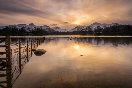 Derwent Water and Catbells  The sun goes down behind Catbells and Derwent Water on a winters day photo
