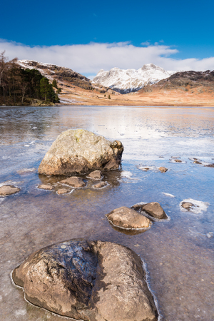 fells: Frozen Blea Tarn portrait  Blea Tarn is a remote  small lake among the Langdale Fells in the Lake District