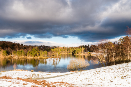 tarn: Tarn Hows in Winter  Tarn Hows is located between the villages of Coniston and Hawkshead in the Lake District
