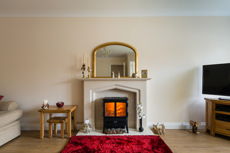 hearth and home: Fireplace in living room  Modern Living Room with log burner in fireplace as central focus Stock Photo