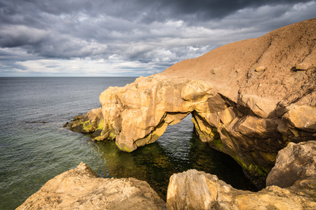 saddle: Saddle Rocks at high tide  Saddle Rocks at Cullercoats Whitley Bay here at high tide on a cloudy day