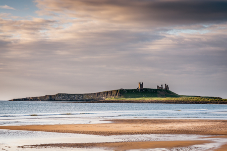 provide: Dunstanburgh Castle from Embleton Bay  The majestic ruins of Dunstanburgh Castle provide the dramatic backdrop to the beautiful Embleton Bay