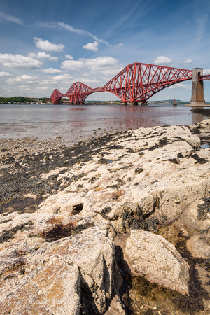 forth: Forth Cantilever Bridge portrait  The famous Forth Cantilever Railway Bridge spans the Firth of Forth on a sunny day Stock Photo