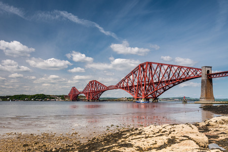 forth: Forth Cantilever Bridge  The famous Forth Cantilever Railway Bridge spans the Firth of Forth on a sunny day Stock Photo