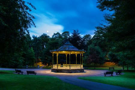 bandstand: Hexham Bandstand at night - The historic Market Town of Hexham sits in the Tyne Valley in Northumberland. The skyline is dominated by the Abbey beside this Bandstand Stock Photo