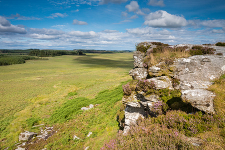 the crags: Sunny Day at Wanney Crags - Great Wanney Crag on the edge of Northumberland National Park is a remote escarpment popular with rock climbers Stock Photo