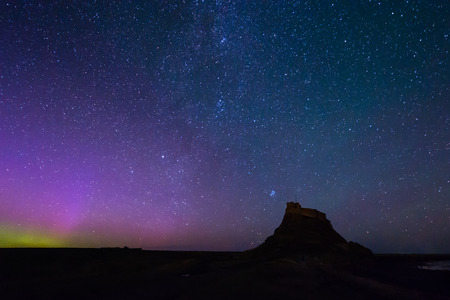 ionosphere: Aurora Borealis over Lindisfarne Castle - The Aurora Borealis  and Milky Way above Lindisfarne Castle on Holy Island in Northumberland