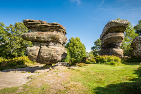 The famous Idol Rock - Brimham Rocks on Brimham Moor in North Yorkshire are weathered sandstone, known as Millstone Grit,creating some dramatic shapes, many of which have been named Stock Photo - 44553866