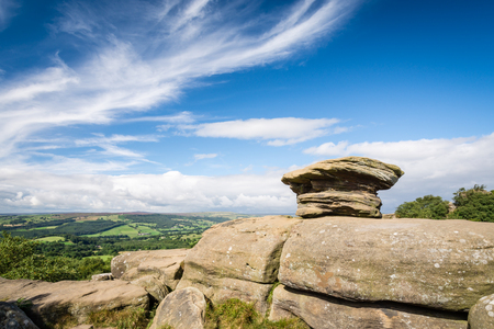 millstone: Brimham Rocks view over Nidderdale - Brimham Rocks on Brimham Moor in North Yorkshire are weathered sandstone, known as Millstone Grit,creating some dramatic shapes, many of which have been named