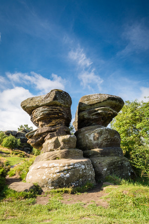 boulder rock: Twin Rocks at Brimham - Brimham Rocks on Brimham Moor in North Yorkshire are weathered sandstone, known as Millstone Grit,creating some dramatic shapes, many of which have been named