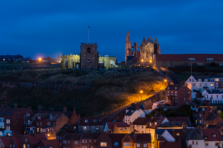 whitby: 199 Steps to Whitby Churches at night  Whitbys famous 199 Steps lead from the town up to the churches of St Mary and the Abbey which dominate the skyline above the harbour, as seen at night