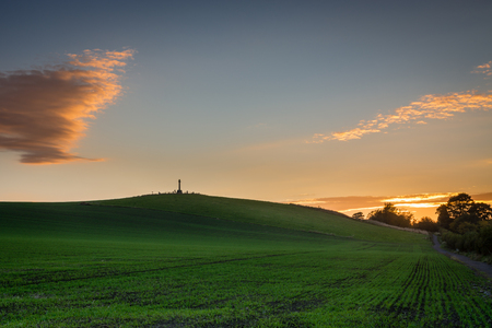 battle cross: Flodden Field at Sunset - In 1513 next to Branxton Village the Battle of Flodden Field took place. The cross is a Monument on Pipers Hill Stock Photo