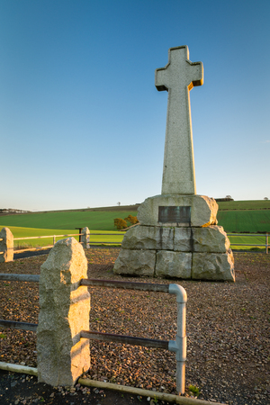 battle cross: Flodden Monument - In 1513 next to Branxton Village the Battle of Flodden Field took place. The cross is a Monument on Pipers Hill Stock Photo