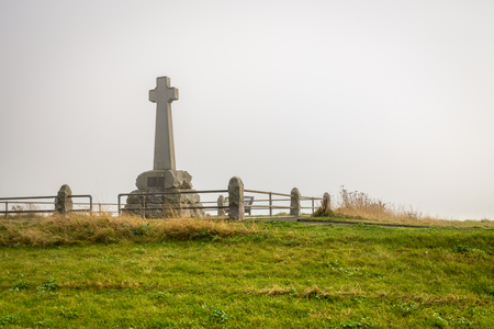 battle cross: Flodden Monument in Fog - In 1513 next to Branxton Village the Battle of Flodden Field took place. The cross is a Monument on Pipers Hill Stock Photo