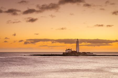 Dawn at St Marys Lighthouse - St Marys Lighthouse on a tiny island just north of Whitley Bay on the coast of North East England. At low tide a causeway allows access
