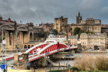 swing: Newcastle Keep beyond the Swing Bridge - The Swing Bridge occupies the position of the original Tyne crossing. Beyond is the Castle Keep to protect it and St Nicholas Cathedral Editorial