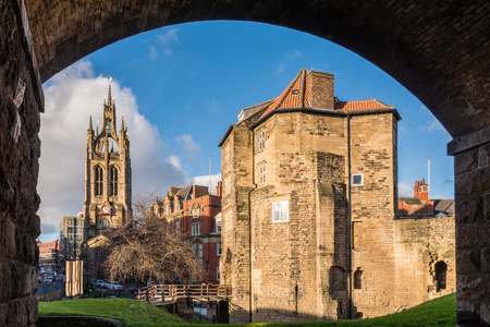 st nicholas cathedral: Framed Black Gate and St Nicholas Cathedral - The Black Gate gatehouse of The Castle with the Cathedral Church of St Nicholas in the heart of Newcastle upon Tyne Editorial