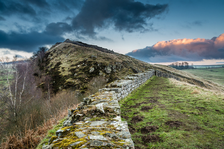 Hadrian's Wall above Cawfield Crags - The Pennine Way walking trail joins the Roman Wall at this section,which is a UNESCO World Heritage Site Stock Photo