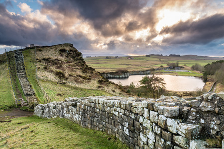 Hadrian's Wall above Cawfield Quarry - The Pennine Way walking trail joins the Roman Wall at this section, Stock Photo