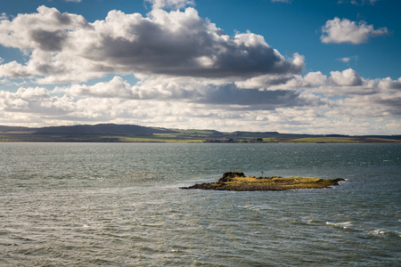 Small Island of Hobthrush, or St Cuthberts Isle. The remains of a small medieval chapel marked with a cross.