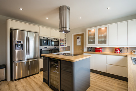 Modern kitchen with island, high gloss units and rounded corners Stock Photo - 56444213