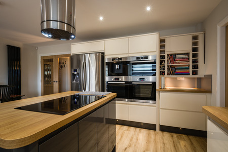 Modern glossy kitchen with rounded corners and an island Stock fotó