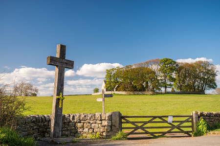 oswald: Wooden Cross at Heavenfield - A delightful hilltop church in Northumberland believed to be the location where King Oswald raised a large wooden cross before the Battle of Heavenfield AD 635 Stock Photo