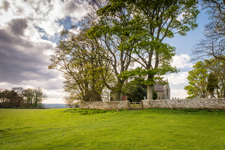oswald: St Oswalds Church Heavenfield - A delightful hilltop church in Northumberland believed to be the location where King Oswald raised a large wooden cross before the Battle of Heavenfield AD 635 Stock Photo