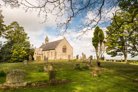 oswald: St Oswalds Church Graveyard - A delightful hilltop church in Northumberland believed to be the location where King Oswald raised a large wooden cross before the Battle of Heavenfield AD 635