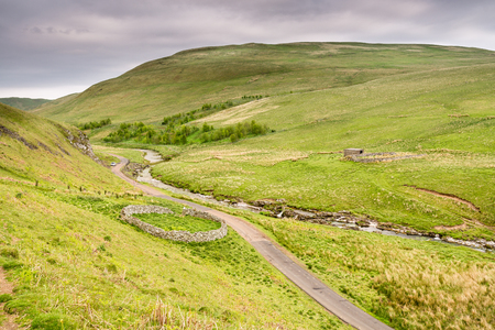 sheepfold: Upper Coquetdale Sheepfolds - The River Coquet winds its way through Upper Coquetdale Valley past many circular sheepfolds, protection in the harsh winters