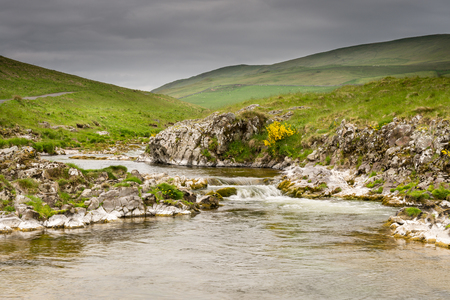 River Coquet cascades down Coquetdale - The River Coquet winds its way through a remote Coquetdale Valley in the Cheviot Hills