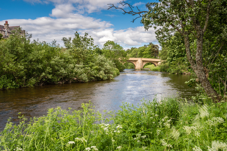 River Coquet at Rothbury - The lush summer vegetation along the River Coquet at Rothbury, Northumberland Stock Photo