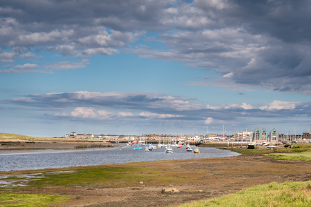 River Coquet flows passed Amble Harbour,  where it meets the sea 免版税图像