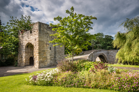 Old Medieval Bridge at Warkworth, is one of just two fortified bridges in Briton Stock Photo
