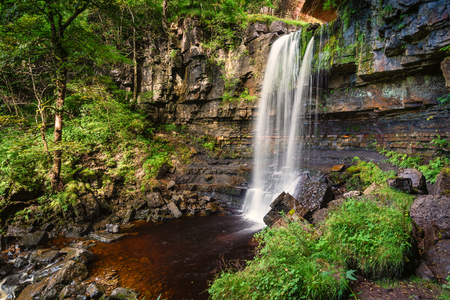 gill: Waterfall at Ashgill - Ash Gill flows over this waterfall, just before it enters the River South Tyne, near its source on Alston Moor, in the North Pennines Stock Photo