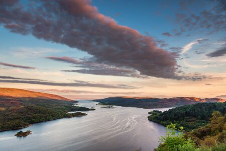 Kyles of Bute at Sunset, also known as Argylls Secret Coast, in the Firth of Clyde, looking down the eastern Kyle with warm sunlit hilltops