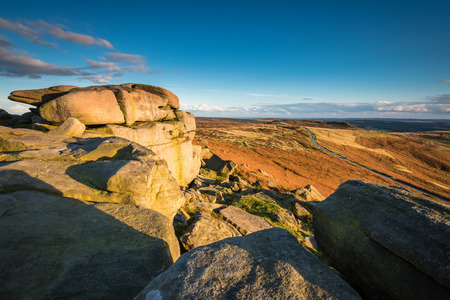 View from Stanage Edge, which is located in the Peak District National Park in England. Stanage Edge is the largest of the gritstone edges that overlook Hathersage in Derbyshire Stock Photo