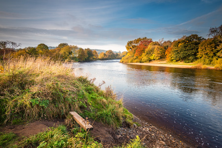 River Tyne formed from North and South Tynes, as they converge at the confluence, near Warden in Northumberland. Also known as, The Meeting of the Waters, seen here in autumn