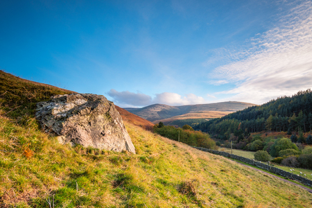 hill range: The Cheviot from Coldburn Hill, from which the hill range takes its name, and is the highest point in Northumberland, located in the Anglo-Scottish borders, seen here in autumn